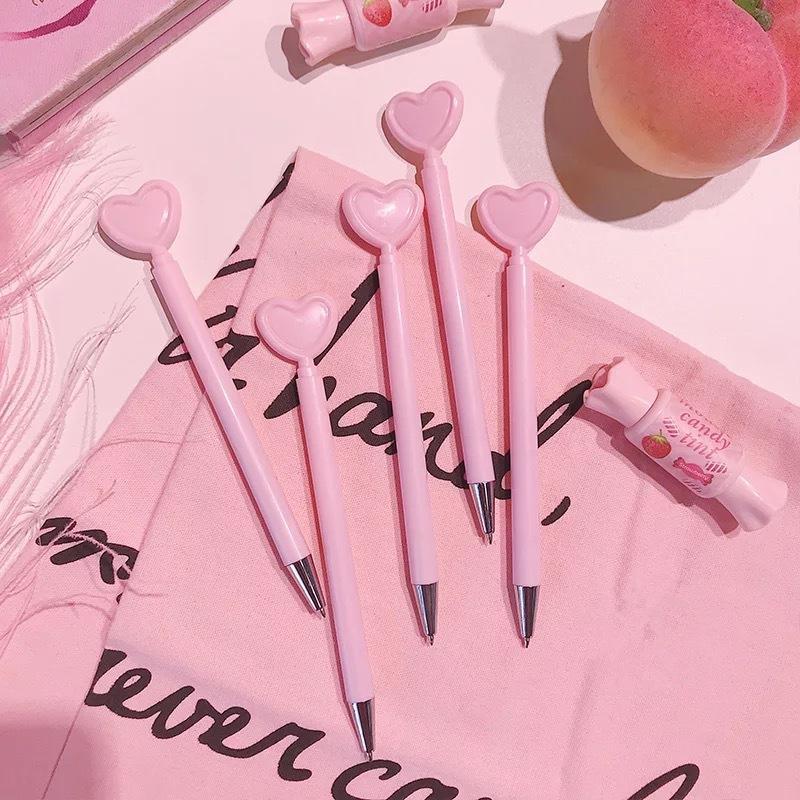 Criativo caneta em forma de coração menina rosa amor gel caneta estudante escritório papelaria preto ins Props crianças presentes Magia 2 peça