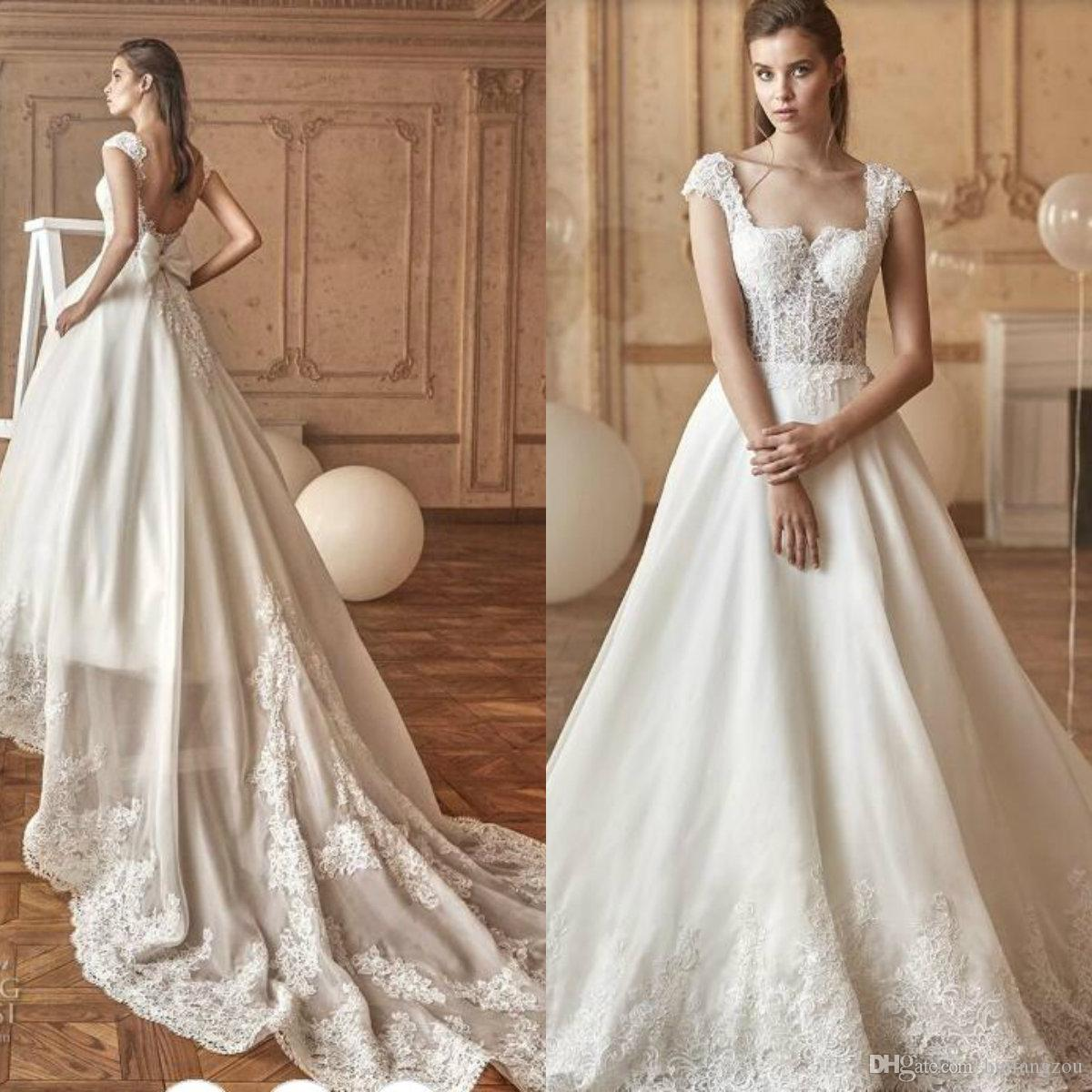 Vestido de boda de la princesa de la vendimia Ilusión blusa de encaje deshuesado expuesto Apliques Bow Backless vestidos de novia barrer vestidos de boda del tren