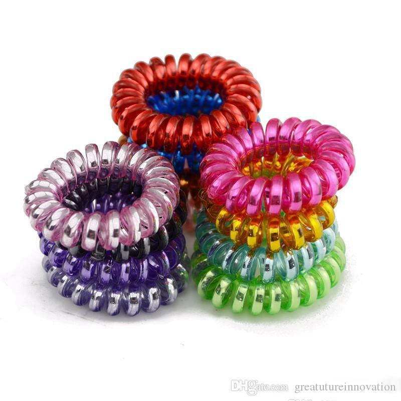 Venta caliente Teléfono Wire pelo elástico Lazos anillos de goma del Ponytail de las vendas de las pulseras Accesorios para el cabello