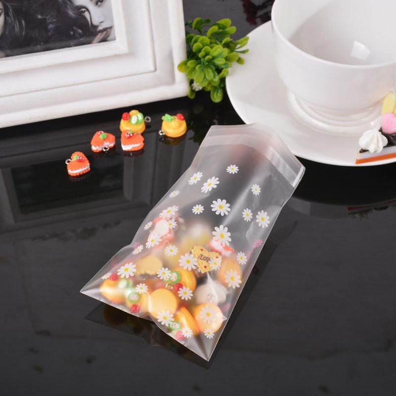 FUNIQUE 50PCS auto-adhésif Seal Sacs fleur de marguerite plastique givré bijoux sac-cadeau Cookie stockage cadeau Package13cmx7.8cm