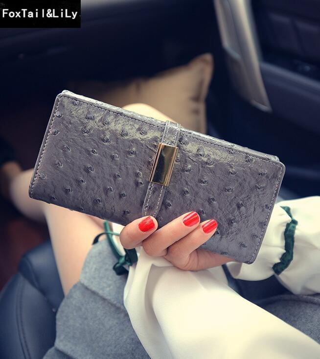 Factory direct selling bag fashionable ostrich stripes long wallet elegant leather lady's hand purse Korean leather seventy percent off wome