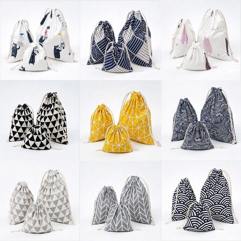10 colores impresos de algodón de lino bolsa de almacenamiento con cordón regalos del caramelo bolsa de embalaje de 3pcs / lot Saco Bolsas de Navidad Bolsa de regalo