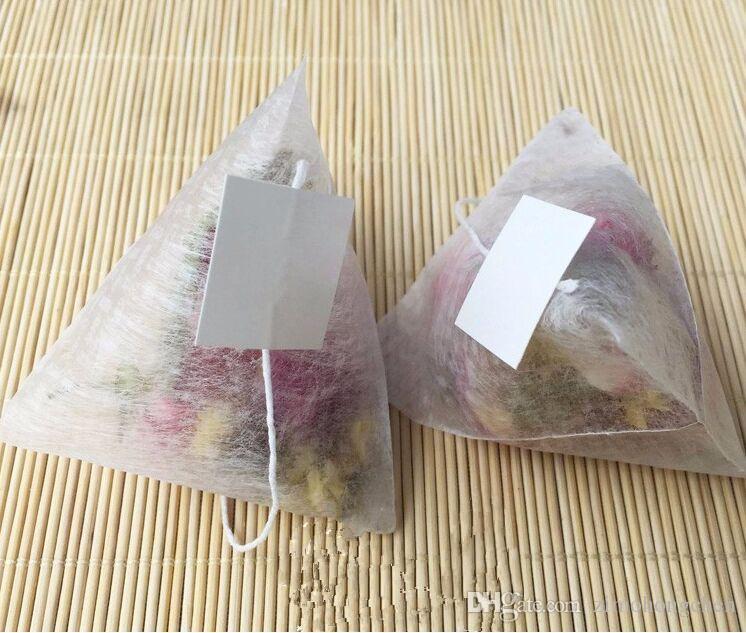 100pcs / lot PLA biodegrada té filtros de fibra de maíz bolsas de té de forma cuadrangular Pirámide sellado en caliente bolsas filtrantes de calidad alimentaria 55 * 70mm el envío libre