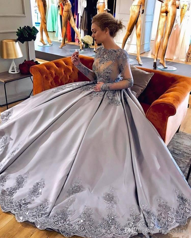 2019 Lilac Plus Size Ball Gown Prom Dresses Bateau Neck Long Sleeves Crystal Appliques Satin Sparkly Evening Gowns Formal Celebrity Dresses