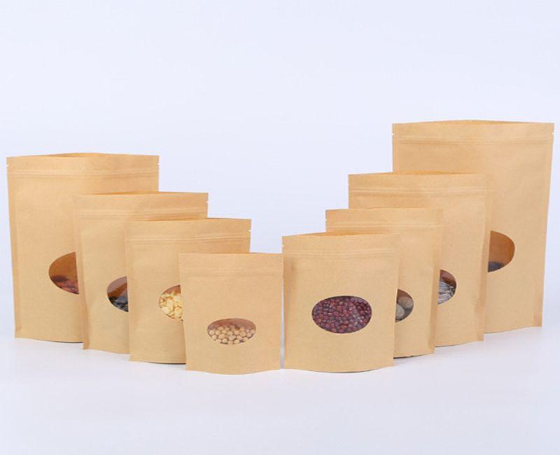 500 pz / lotto chiusura a cerniera in piedi sacchetti di carta kraft con finestra rotonda giallo kraft pacchetto di stoccaggio alimenti secchi frutta tè sacchetti di prodotto elettronico