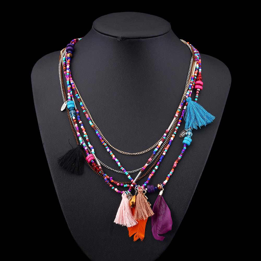 Collier couche de perles ethniques charmes pompon bijoux tribaux plume boho collier pour les femmes