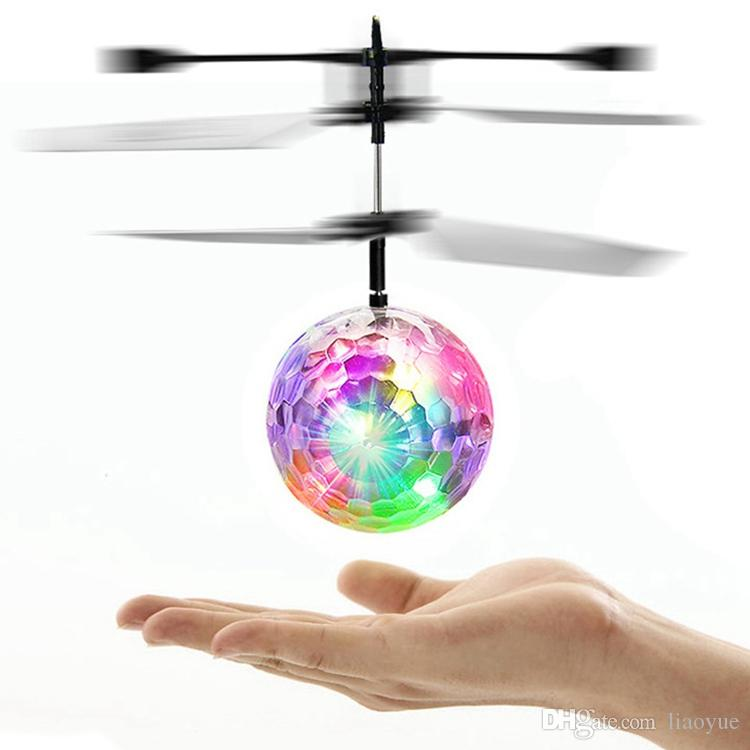 RC Toy RC Flying Ball Infrared Induction Helicopter Ball with Rainbow Shinning LED Lights and Remote Control Flying Toys for Kids