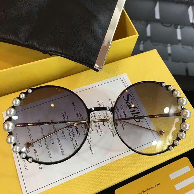 Mujeres 0295S Gafas de sol redondas ff0295 Lentes Negro perlas redonda blanca redonda de la manera de los vidrios de las gafas de sol al aire libre Eyewear nuevo con la caja