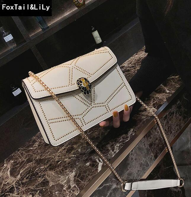 Factory direct selling brand female bag personality rivet women hand bag fashion snakehead chain European and American leather shoulder bag