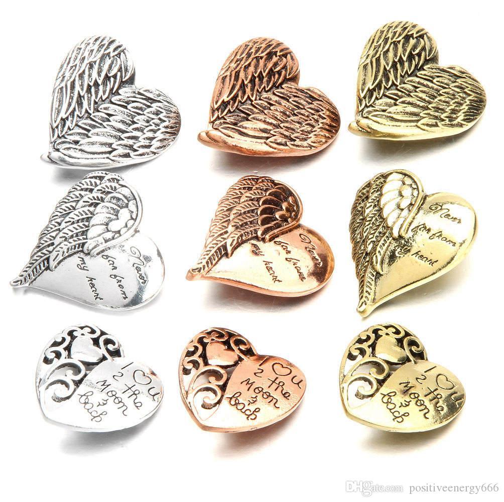 20pcs / lot I più nuovi gioielli a scatto Angel Wings Love Heart metallo 18mm Snap Button Charm Noosa pezzo Fit braccialetto fai da te anello collana