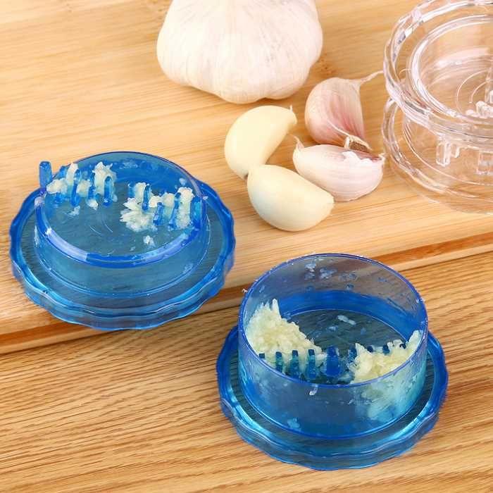 100pcs di plastica Aglio Press Aglio Stir Peeler Crusher Twist Taglierina di verdure Grattugia Accessori da cucina Strumenti di cottura