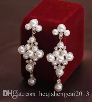 Livraison gratuite élégante dame boucles d'oreilles mode européenne et américaine vintage tribunal exquise perle élégante boucles d'oreilles mode classique exquis n