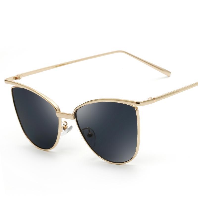 Moda sencilla Diseñador de marca de estilo europeo Personalidad ojo de gato gafas de sol100% gafas anti - UV gafas de sombrilla de alta calidad con caja