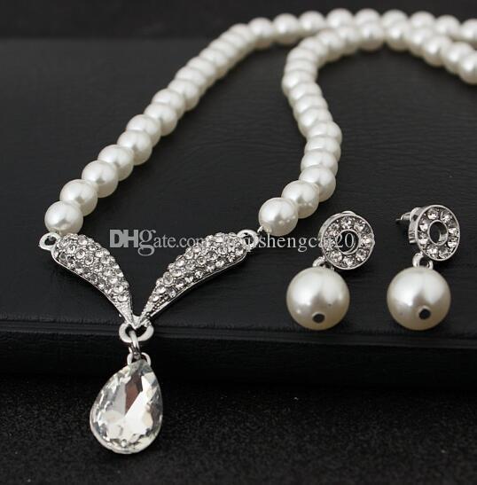 Бесплатная доставка Корейская версия популярного жемчуга ожерелье серьги набор свадебные свадебные украшения набор 2 штуки моды классический элегантный
