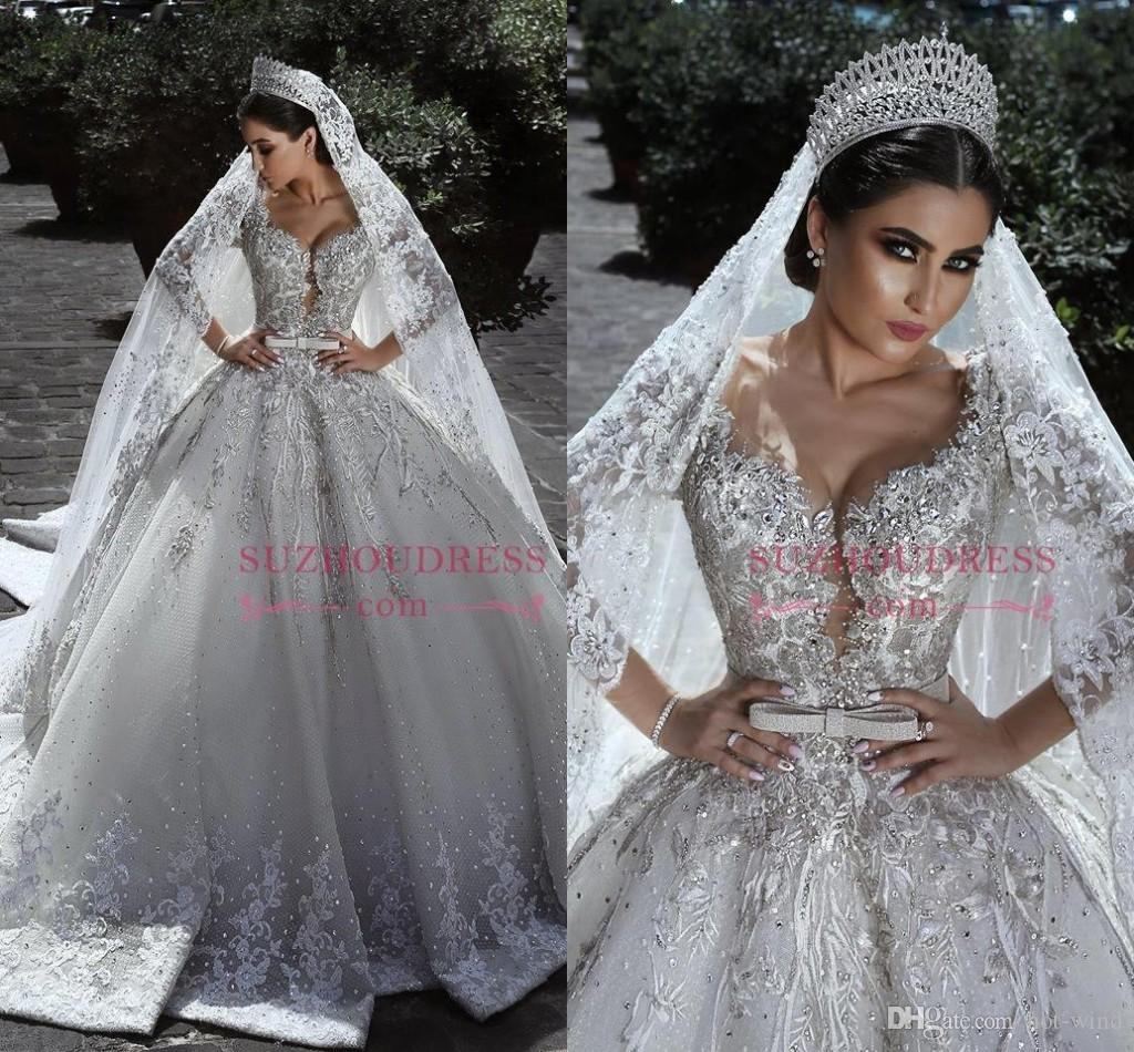 2019 New Arrival Luxury Crystals Beaded Wedding Dresses Sheer Long Sleeves Lace Appliqued Country Style Wedding Bridal Gowns Custom Made