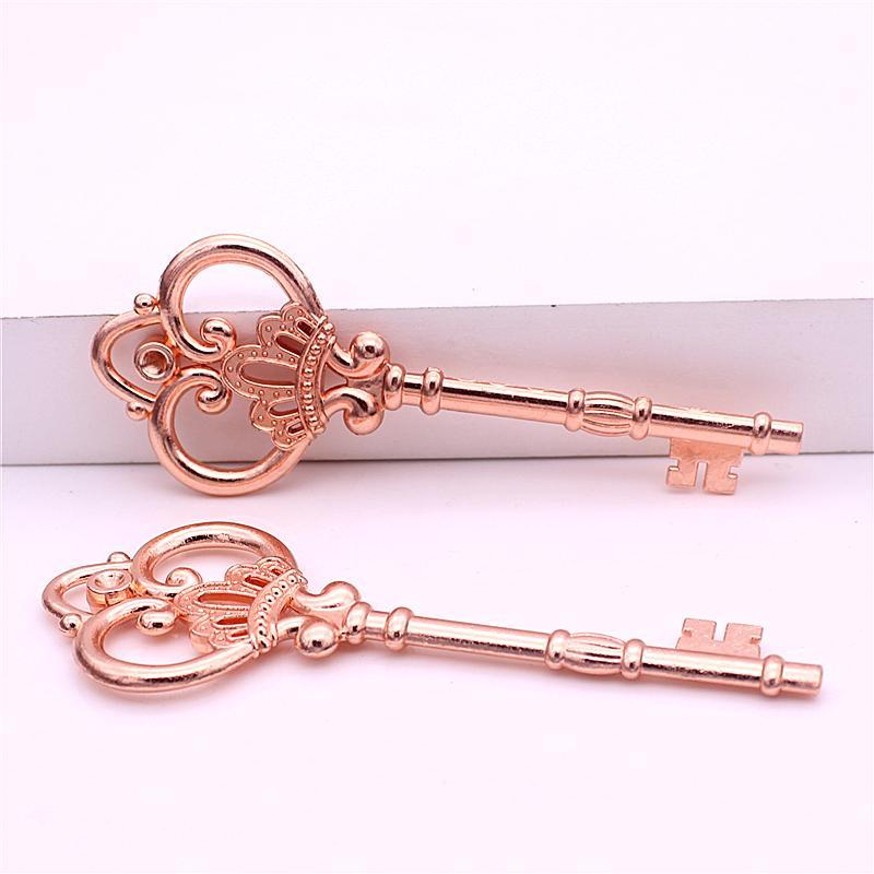 Słodki Dzwon 10 sztuk / partia 32 * 84mm Rose Gold Charm Antique Metal Stop Piękny Duży Koron Key Charms Vintage Klucze jubilerskie D0182-1