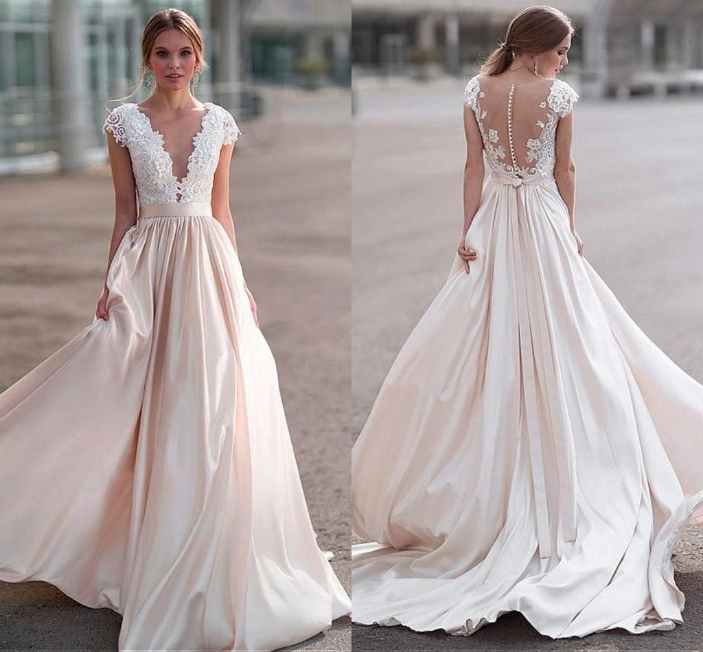 Wspaniała aplikacja koronkowa suknie ślubne z iluzją głęboką dekolt satynową A-Line Country Suknie ślubne Beach Sukienka ślubna