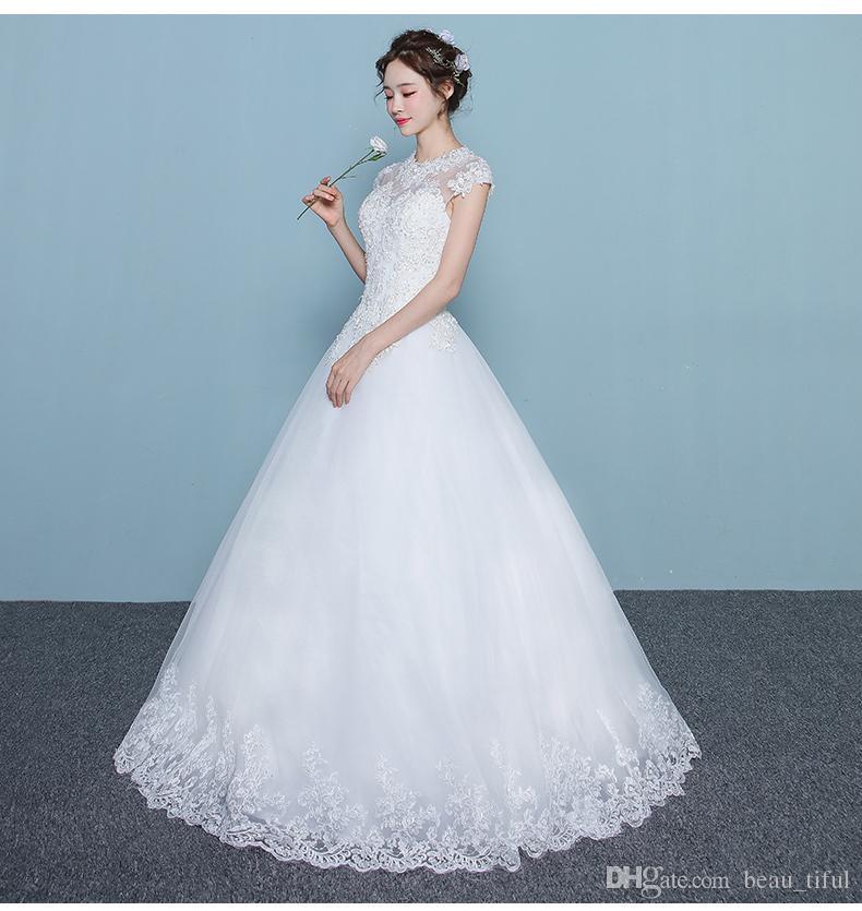 Envío gratis Robe de Soiree 2019 Una línea de vestidos de novia Venta caliente Sparkle cuello alto hasta el suelo sin mangas de encaje con apliques