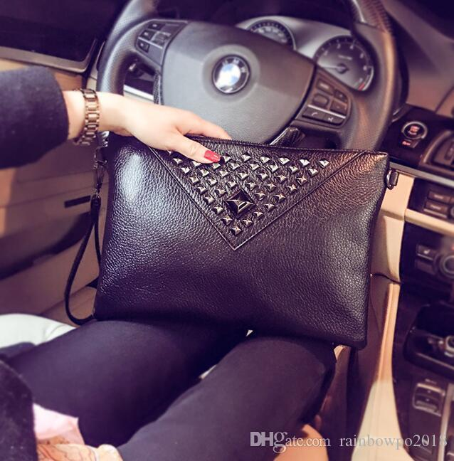 Factory direct brand men bags soft leather hand bag new rivet personality wrist bag large capacity rivet leather envelope bag