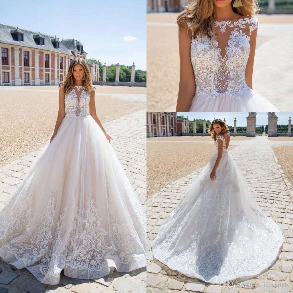2019 Abiti da sposa trasparenti Sexy Backless Illusion Paillettes Appliques Cap Sleeves Sweep Train Abiti da sposa Custom Made