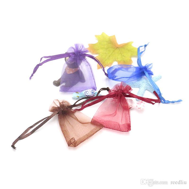 Hot! Avec cordon de serrage Organza Bijoux PouchesBags 300pcs / lot Favor cadeaux Sacs de rangement perle de soirée de mariage Décoration de Noël coloré