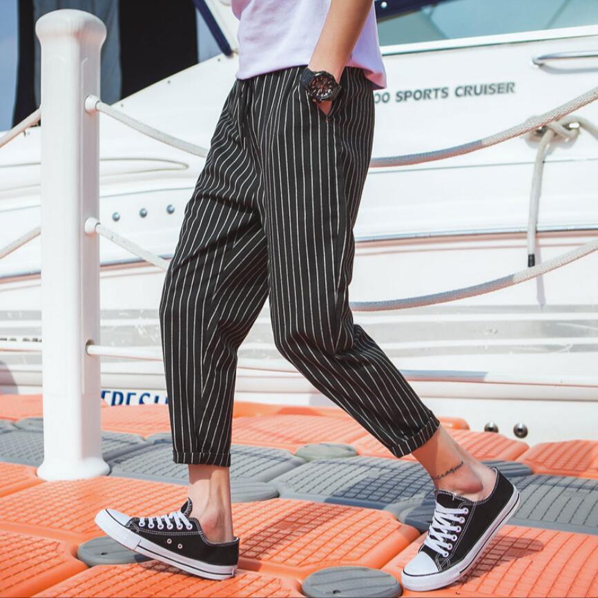 Compre Pantalones M 5xl Version Coreana Para Hombres Tendencia Pies Sueltos Pantalones Casuales Rayas Verticales Nueve Estilista Personalidad Haren A 45 13 Del Mangcao Dhgate Com