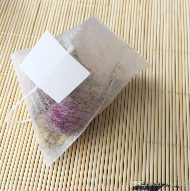 PLA biodegrada té filtros de fibra de maíz 100 pedazos / porción té bolsas de forma cuadrangular Pirámide sellado en caliente bolsas filtrantes de calidad alimentaria 55 70 mm *