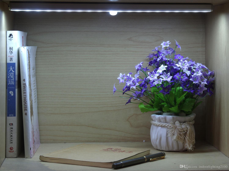 Estilo creativo portátil recargable por inducción noche se enciende la lámpara del sensor LED de luz en el pasillo dormitorio de la lámpara de iluminación Gabinete de pared sensor de emergencia