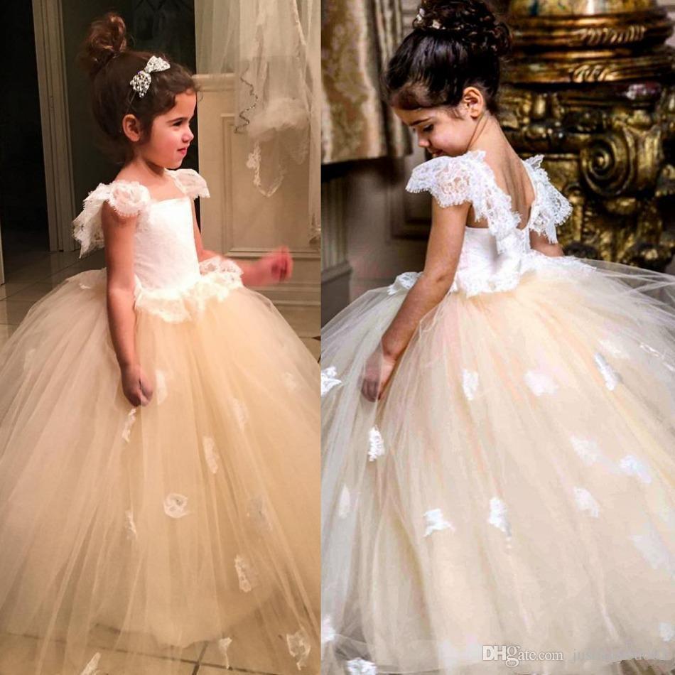 Großhandel Puffy Blumenmädchenkleider Für Hochzeiten Günstige Bodenlangen Cap Sleeve Spitze Tüll Weiß Erstkommunion Kleid Kostenloser Versand ...