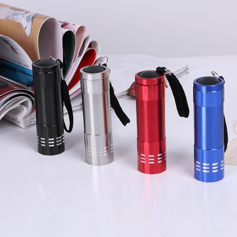Lampe de poche portable à 9 lampes de poche à DEL pour le cyclisme en plein air avec zoom UV en aluminium avec lumière ultra-violette
