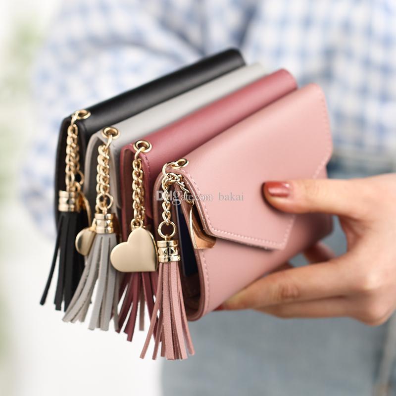 Pequeño de nuevo bolso corto pequeño japonés coreano estudiante fresco moda linda y borla mujer mini version billetera cartera odbki