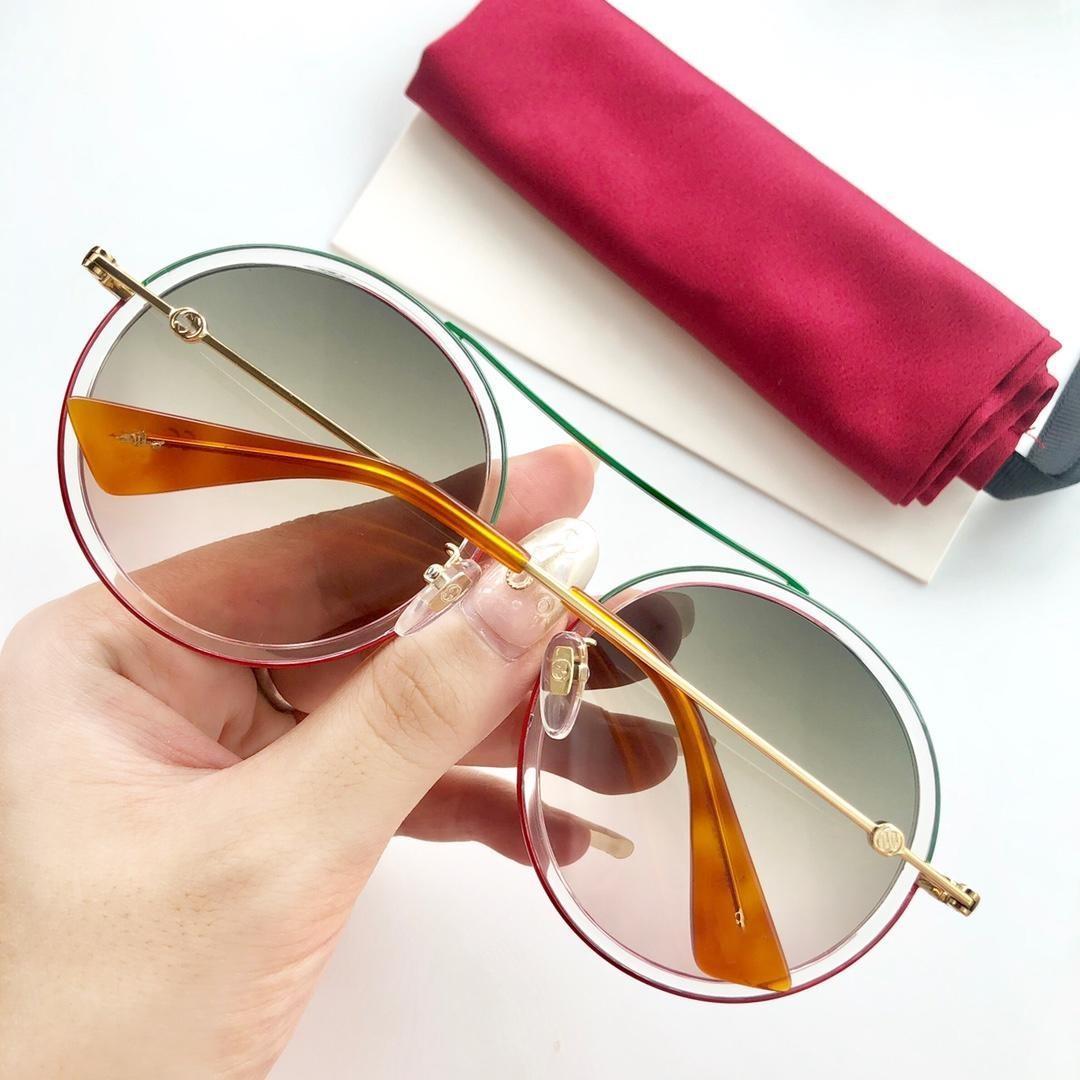 Gafas de sol de diseñador de mujer de lujo 0061 Estilo de moda Color mixto Marco redondo retro para mujer Gafas de alta calidad Lente de protección UV 0061S