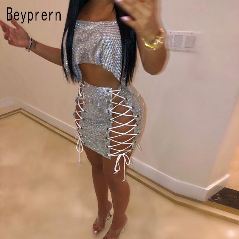 Beyprern seductor Festival celebridades Metal cristal diamantes falda conjunto brillante vendaje encaje hasta lentejuelas Mini falda conjunto de dos piezas