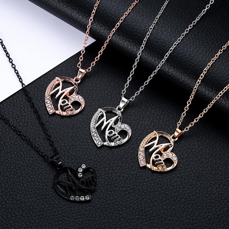Collar de diseño único para las mujeres Regalo del día de la madre para la mamá ahueca hacia fuera la aleación de plata de oro metal cristal corazón colgante collar