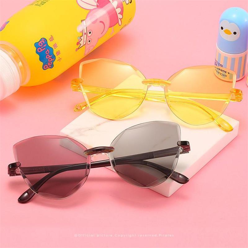 Moda Niños sin montura de las gafas de sol del ojo de gato Gafas de sol anti-UV Gafas de bebé gafas anteojos Adumbral ornamental A ++