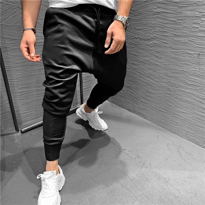 Calças cor de bolso com cordão Homme Vestuário Moda Estilo Sports Hetero Mens Designer Pants 2020 Casual Sólidos