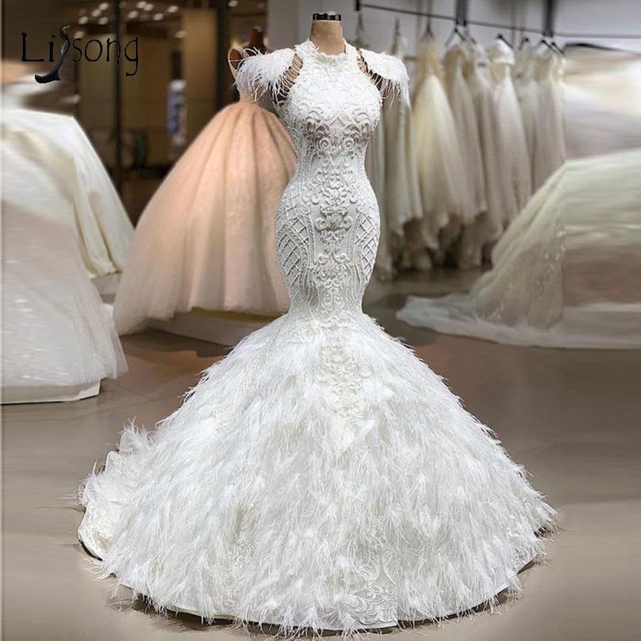 Vintage dentelle Appliqued col montant sirène robes de mariée luxe arabe grande taille robe de mariée balayage train avec des plumes