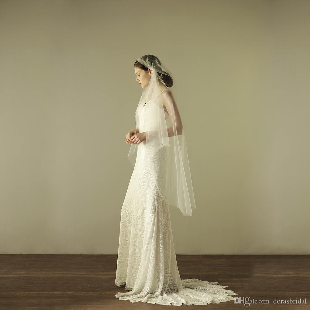 Nuevos velos de novia con peine Piezas de cabello de boda Un nivel de tul Dedo Longitud de la cabeza Auriculares nupcial Velo de novia Largo Blanco DB-V604