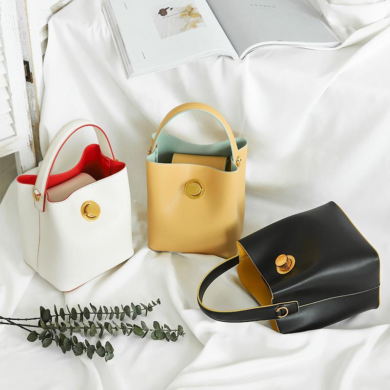2020 Nova Couro Bolsas Niche Designer de correspondência de cores Ampla alça de ombro portátil Bucket Bag Shoulder Messenger Bag pequeno