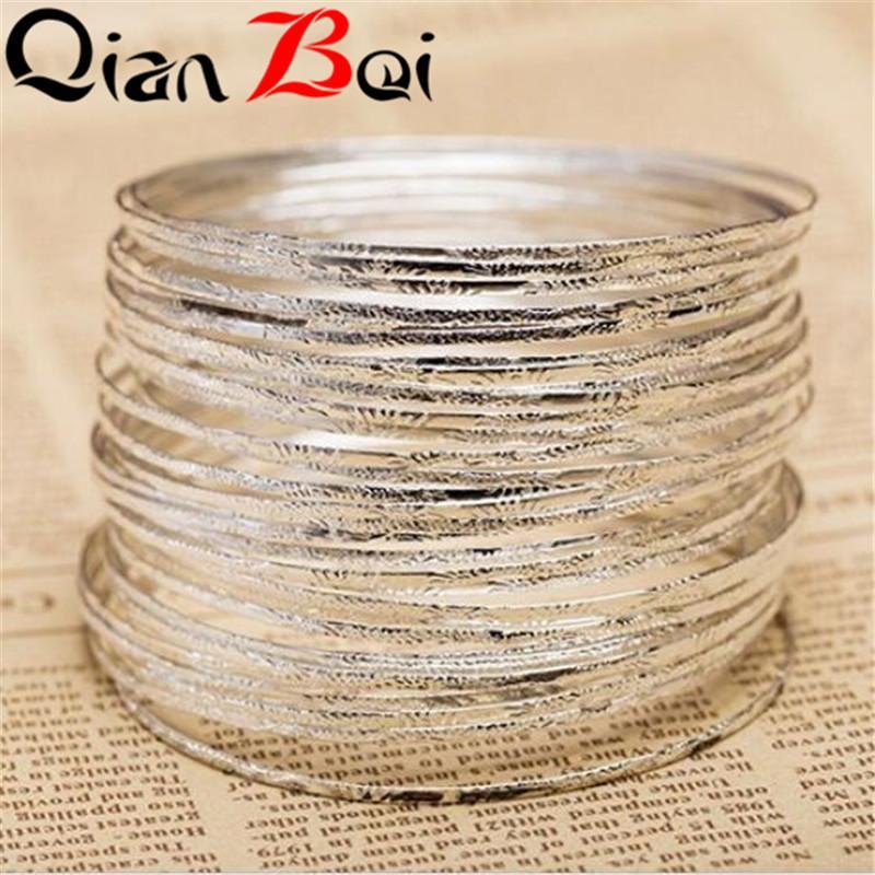 QianBei 10pcs / set di modo inciso increspato dei monili del partito del braccialetto dei braccialetti del cerchio di Dimpled dei monili incastonati modo delle donne Trasporto libero