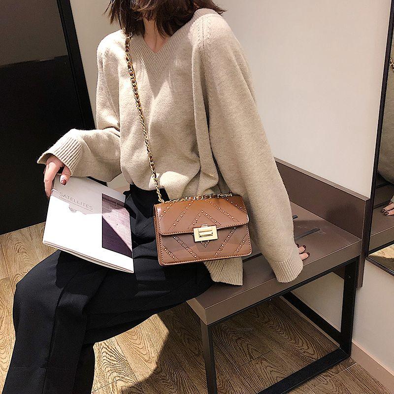 Diseñador-2019 del remache llano bolsa de damas cadenas de moda bolsas bolso de hombro bolsa de rayas de la manera Xinda / 12