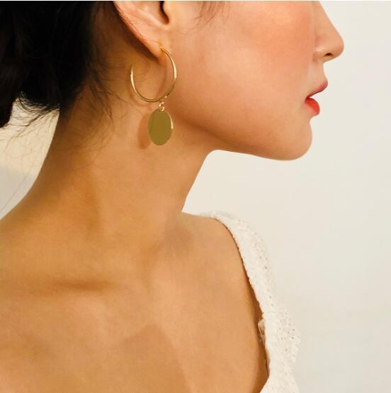 cuivre style de tir rue de la mode européenne et américains bijoux oreille tempérament sequin simple, personnalisé earrings298