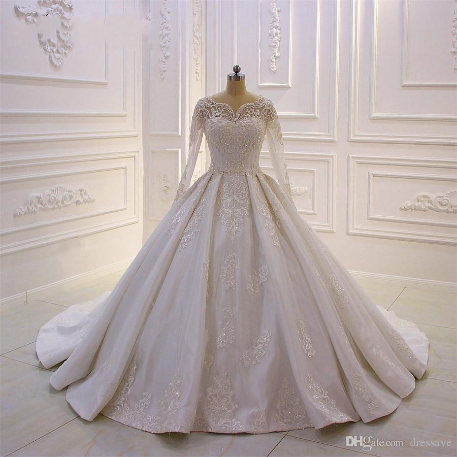 Abiti da sposa di nuovo design Abito da sposa in perle con applique in pizzo con abito da ballo a maniche lunghe Bottone posteriore Sweep Train Custom