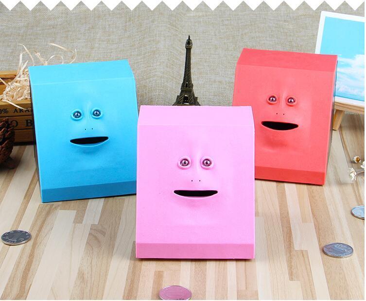 Nuovo volto strano Mangiare denaro Piggy Bank bancaria del fronte creativo di induzione elettrica Flat Face Toy Piggy Bank