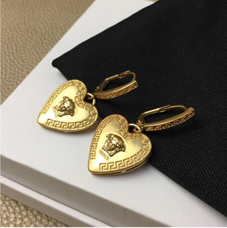 Neue Art weibliche Mode Persönlichkeit Netto-rotes Herz Ohrringe Seiko hochwertige Kopf-Herz-Ohrringe