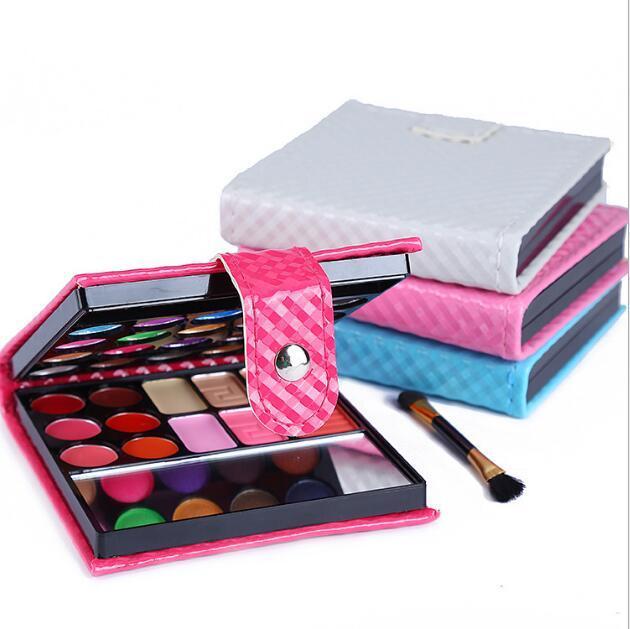 Los conjuntos de paletas de maquillaje de 32 colores iluminan el color de la piel con un pincel de brillo y brillo con una cartera de color rosa / rojo / azul