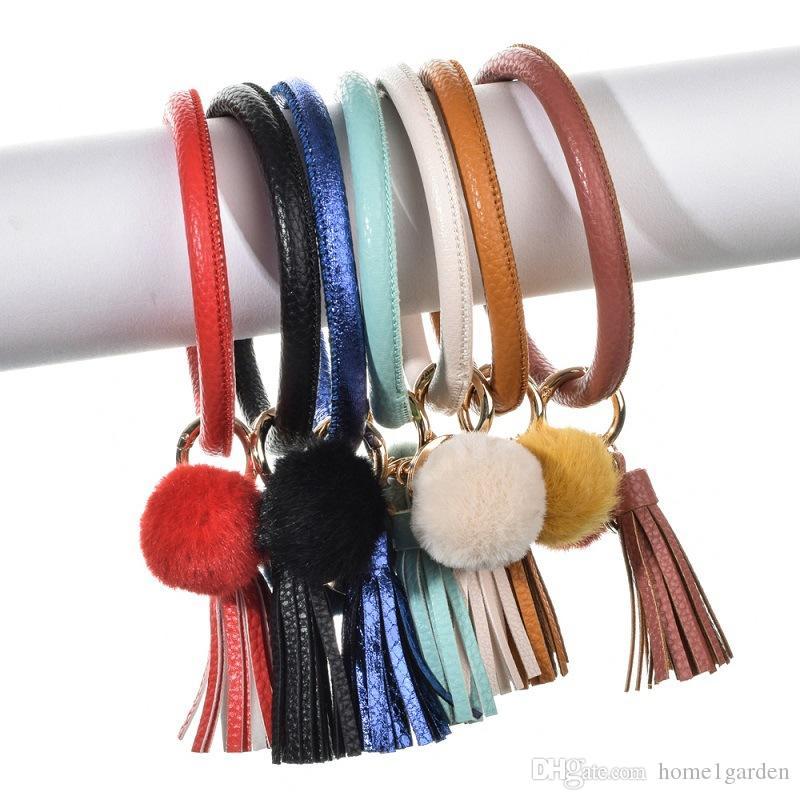 Neue PU-Leder-Troddel-Pom Pom-Armband-Schlüsselring-Haar-Kugel-Armband-Schlüsselanhänger Größe 8cm 7 Farben