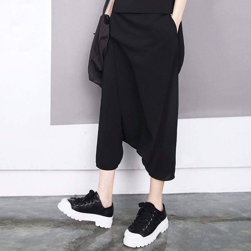 Pantalones Mujer Pantalones Mujeres Pantalones estilo de las mujeres negras de verano elástico de la cintura pantorrilla suelta Boho niñas Streetwear pantalones casuales 1493 de la Cruz