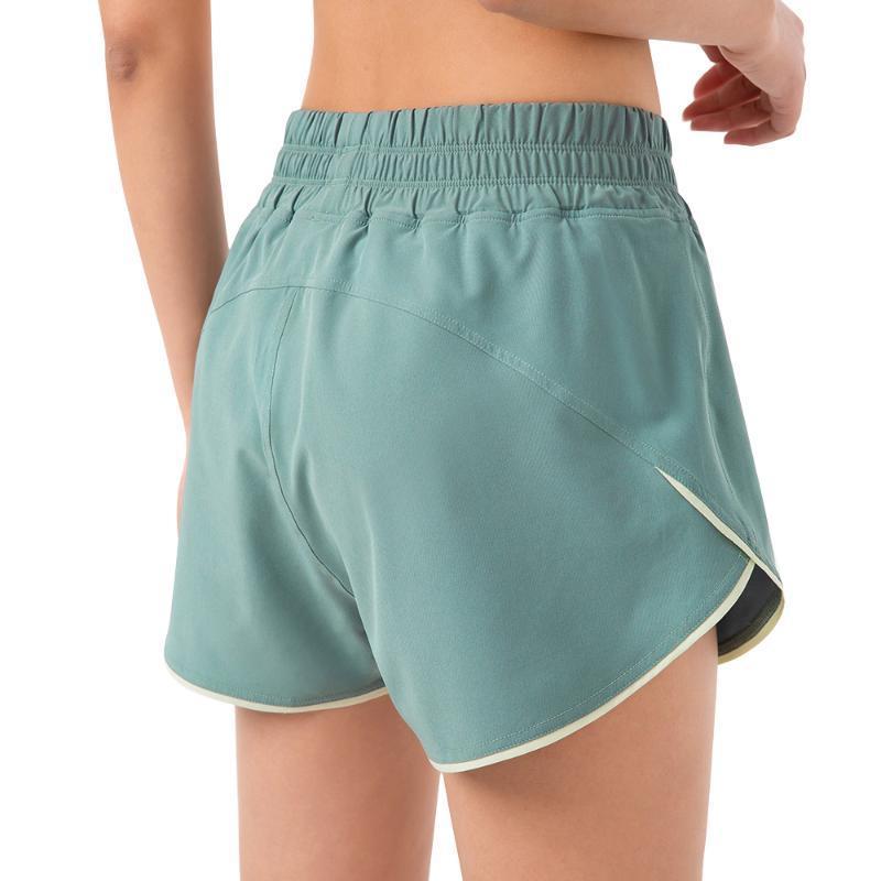 Trajes de yoga Sport Woman Shorts Cintura elástica Poliéster Secado rápido Jogging Femme Entrenamiento para Fitness Flojo Fake Two Piece Casual