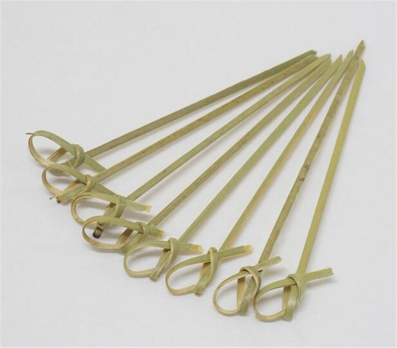 Nuevo comedor 100 piezas / bolsa desechable de bambú lazo anudado Pinchos extremos retorcidos cóctel de frutas Alimentación Selecciones Tenedor Sticks Buffet Primeros de la magdalena